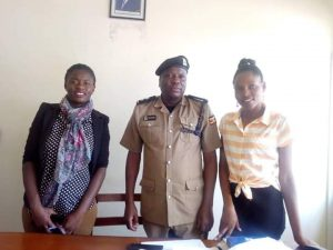 The WHRNU secretariat pose for a photo with the Kampala metropolitan spokesperson, Patrick Onyango at Central Police Station.