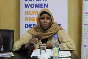 Amina, a woman defender, gives testimony of threats she experienced in her work of defending land rights.