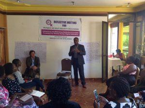 Mr.Fedelis of Frontline Defenders speaks to Women Defenders as Mr.Javier of the UN Office of Human Rights listens in.