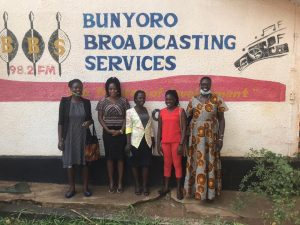 The head of the women defenders with disabilities, a female journalist based in Masindi with the Bunyoro Broadcasting services and  the regional focal person pose for a photo.
