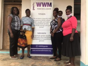 WHRDNU staff poses for a photo with WHRDs from Women With A Mission in Mbale district.