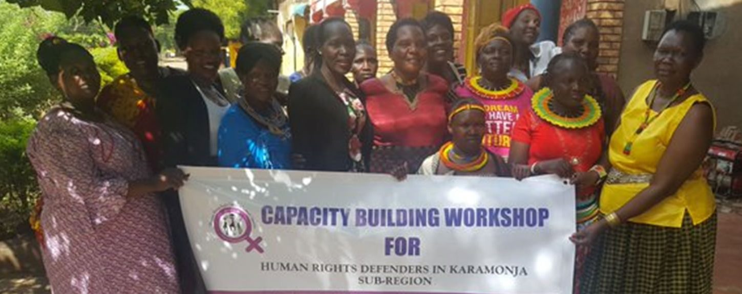 Women defenders in Karamoja Region pose for a photo after a capacity building workshop