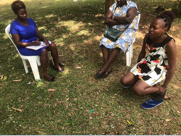 WHRD Mariam Nakku(right) is facing isolation for the work she does