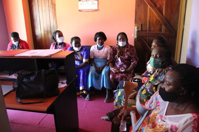 WHRDs of the Acholi Regional Network wait at the reception of Mighty Fire for their radio talk show.